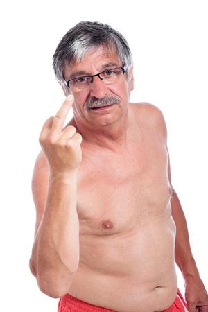 obscene: Angry senior man vulgar gesturing, isolated on white background.