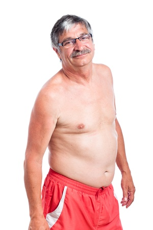 Portrait of sporty shirtless senior man, isolated on white background.
