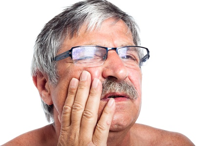 Close up of unhappy senior man with painful toothache, isolated on white background.