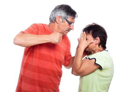 Domestic violence abuse concept, aggressive man going to punch unhappy woman, isolated on white background. photo