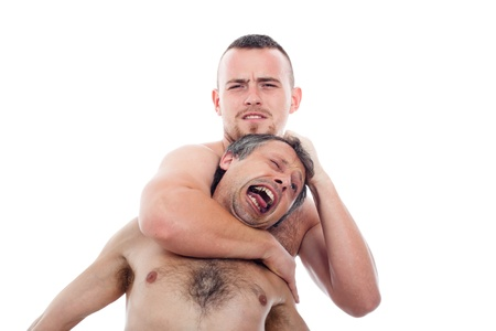 krav maga: Two nude men wrestling, isolated on white background. Stock Photo