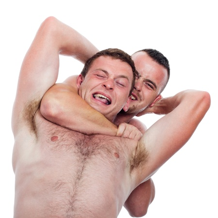krav maga: Two shirtless men fighting and wrestling, isolated on white background.