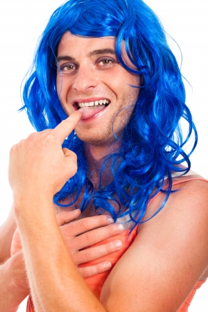 shemale: Close up of funny transvestite in blue wig, isolated on white background.