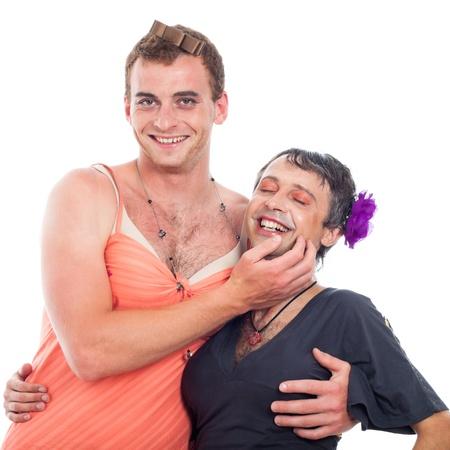 Two laughing transvestites having fun, isolated on white background. Stockfoto