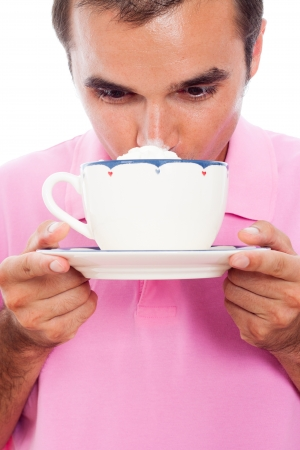 Close up of man drinking coffee with whipped cream. photo