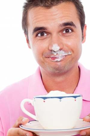 Close up of funny man holding cup of coffee with whipped cream on his face. Stock Photo - 15572371