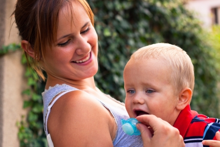 Happy mother and her baby boy enjoying sunny day outdoors. Stock Photo - 15572350