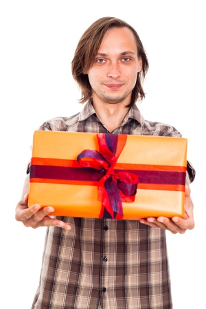 weirdo: Portrait of a man giving gift box, isolated on white background. Stock Photo