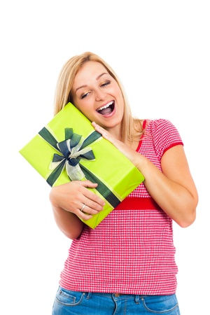 Young attractive blond happy woman holding green gift box, isolated on white background. photo