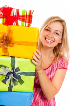 Young attractive blond happy woman and stack of colorful gift boxes, isolated on white background. Stock Photo - 15892005