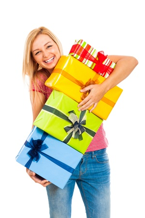 Young attractive blond laughing woman holding stack of colorful gift boxes, isolated on white background. Stock Photo - 15891972