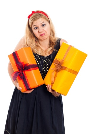 indecisive: Indecisive woman holding two gift boxes, isolated on white background. Stock Photo