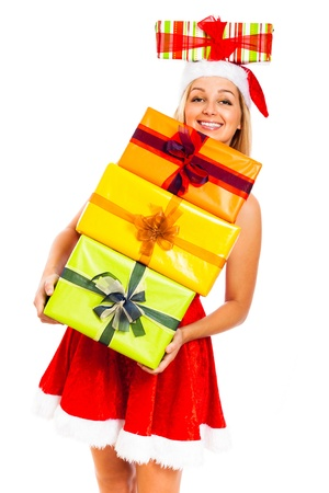 Young attractive blond smiling woman holding stack of colorful gift boxes wearing Christmas Santa costume, isolated on white background. Stock Photo - 16008538