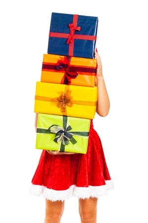 Young woman covered of colorful gift boxes wearing Christmas Santa costume, isolated on white background. Stock Photo - 16008543
