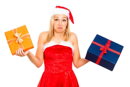 indecisive: Funny indecisive woman wearing Christmas Santa costume holding two gift boxes, isolated on white background. Stock Photo