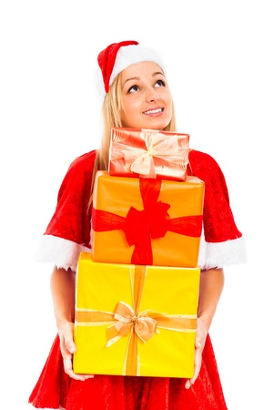 Young beautiful blond smiling woman holding colorful gift boxes wearing Christmas Santa costume and looking up, isolated on white background. Stock Photo - 16008539