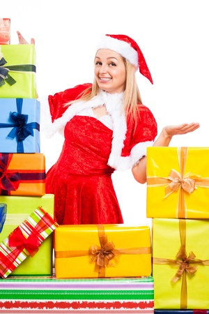 Young blond happy woman wearing Santa costume surrounded by Christmas gift boxes, isolated on white background. Stock Photo - 16008551