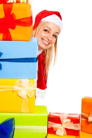 Young attractive blond happy woman in Santa costume surrounded by Christmas gift boxes, isolated on white background with copy space. Stock Photo - 16008545