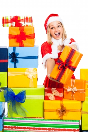 Young blond attractive excited laughing woman in Santa costume holding Christmas gift, isolated on white background. Stock Photo - 16008552