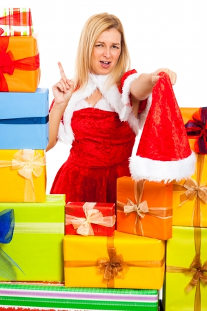 Young blond funny woman in Santa costume surrounded by Christmas gift boxes, isolated on white background. Stock Photo - 16008550