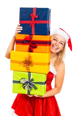 Young attractive blond laughing woman wearing Santa costume holding many colorful Christmas gift boxes, isolated on white background. photo