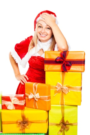 Young beautiful blond happy smiling woman in Santa costume surrounded by Christmas gift boxes, isolated on white background Stock Photo - 16120483