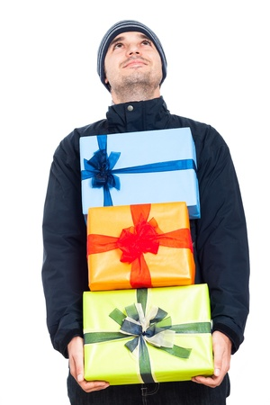 man carrying box: Happy man in winter jacket holding Christmas gift boxes and looking up, isolated on white background
