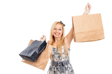 Young attractive blond happy woman holding shopping bags, isolated on white background  Stock Photo - 16120478