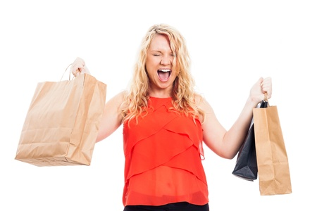 Young attractive blond ecstatic happy woman holding shopping bags, isolated on white background Stock Photo - 16120474