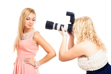photographing: Fashion female photographer working with model, isolated on white background. Stock Photo