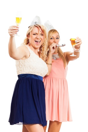 Two young happy women celebrating party, isolated on white background. photo