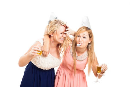 Two young drunken women celebrating with alcohol, isolated on white background. Stockfoto
