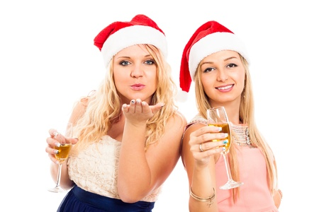 funny glasses: Two young blond happy women celebrating in Christmas hat, isolated on white background.