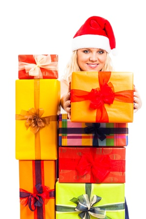 Young attractive blond happy woman in Santa costume with Christmas gift boxes, isolated on white background. Stock Photo - 16120498