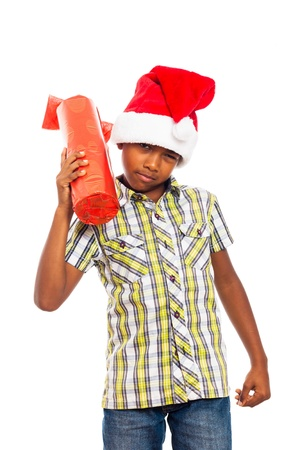Curious boy holding Christmas gift, isolated on white background. Stock Photo - 16250149