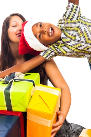 mixed race family: Ecstatic happy child boy and woman celebrating Christmas, isolated on white background.