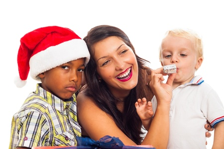 mixed race baby: Young happy woman celebrating Christmas with children, isolated on white background.