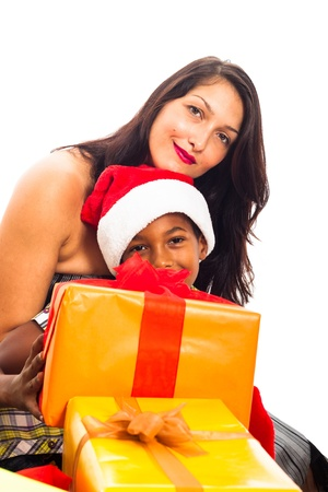Beautiful young woman with child boy and Christmas gift boxes, isolated on white background. Stock Photo - 16250146