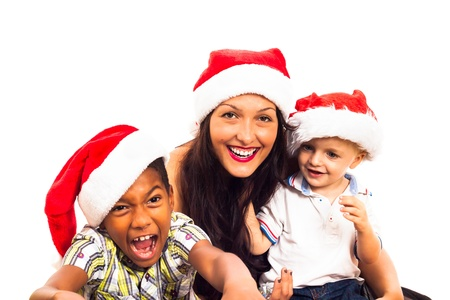 Funny children and woman celebrating Christmas, isolated on white background. Stock Photo - 16250135