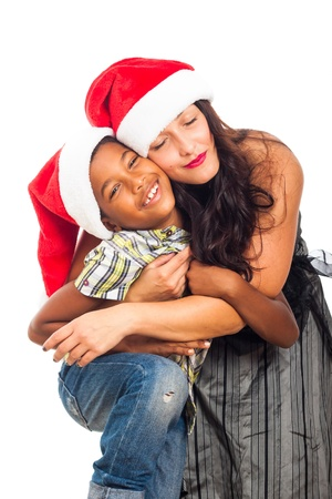 Christmas portrait of beautiful happy young woman hugging child boy, isolated on white background. Stock Photo - 16250132