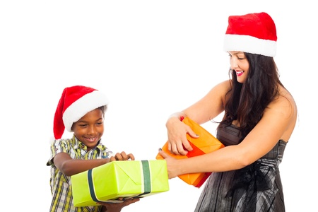 Beautiful young woman and child boy opening Christmas gift boxes, isolated on white background. photo