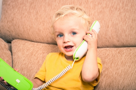 calling on phone: Happy cute adorable child boy on the phone.