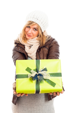 Young happy smiling woman holding green gift box, isolated on white background. photo