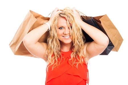 Young attractive blond happy woman carrying shopping bags, isolated on white background. Stock Photo - 16522467