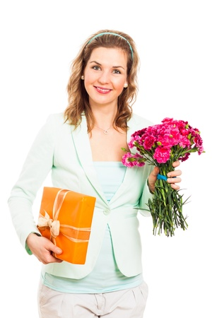 gillyflower: Portrait of young happy smiling woman holding pink flower and gift box, isolated on white background.