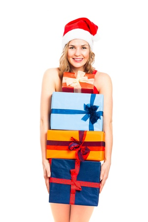 Young happy woman holding stack of colourful Christmas gift boxes, isolated on white background. photo