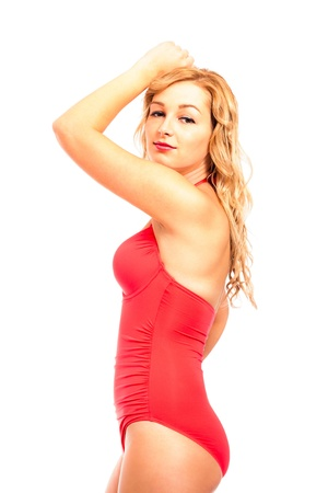 Portrait of young attractive woman in red swimsuit, isolated on white background. Stock Photo - 16757625