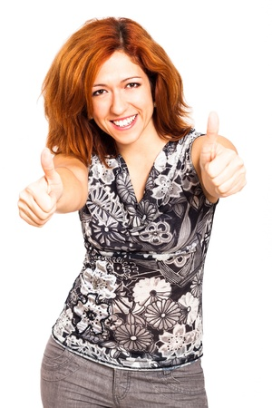 Ecstatic happy woman gesturing thumbs up, isolated on white background. photo
