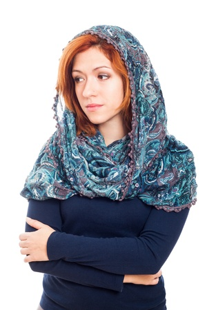 headscarf: Young sad woman wearing blue headscarf, isolated on white background.
