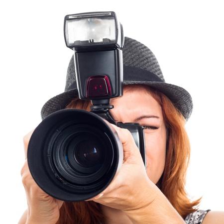 Close up of female photojournalist holding camera, isolated on white background.